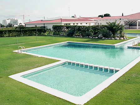Coronaciónd de piscina Menorca en Piedra Artificial