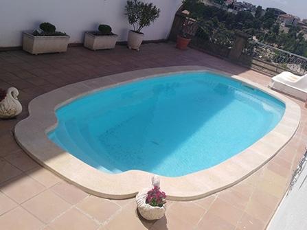 Rehabilitación de piscina en piedra artificial